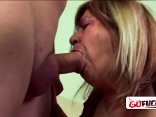 Nasty granny with hanging nipples